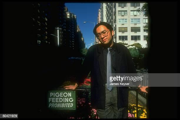 Author Kazuo Ishiguro posing in island on Park Ave