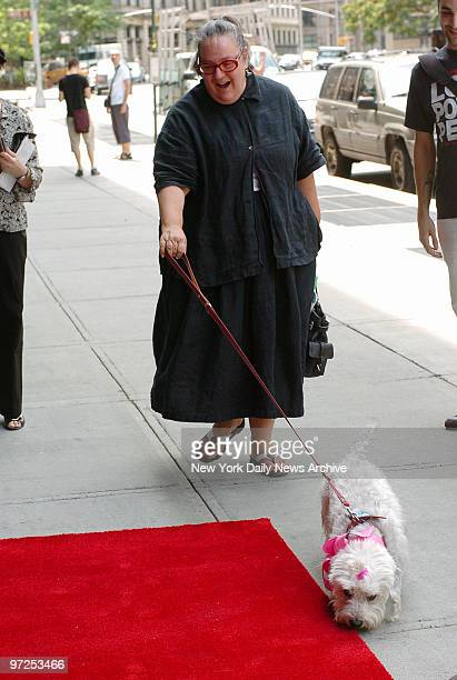 Author Kim Hastreiter and Romeo, her white Dandie Dinmont terrier, arrive at Trinity restaurant in TriBeCa for Romeo's fourth birthday party.