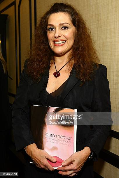 Author Laura Mercier poses for a photo with her new book The New Beauty Secrets Your Ultimate Guide to a Flawless Face at Bergdorf Goodman on...