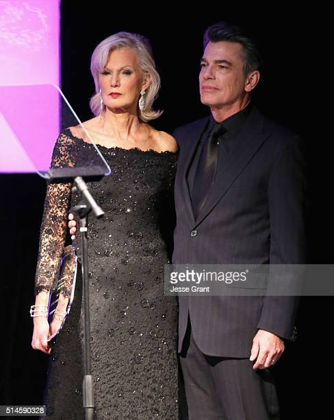 Author Laurie Burrows accepts The Philanthropy Award on behalf of honoree Peter Grad from actor Peter Gallagher onstage during the 24th and final A...