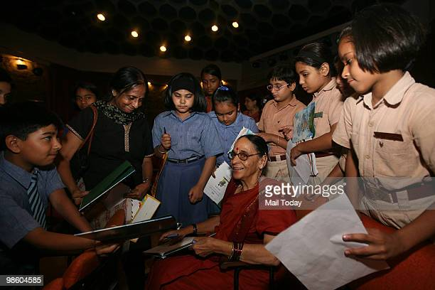Author Leila Seth signs the copies of the book We The Children Of India The Preamble To Our Constitution at its launch in New Delhi on April 20 2010