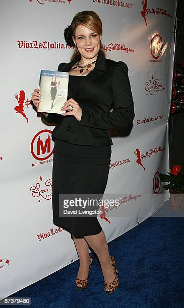 Author Lily Burana poses with her book I Love a Man in Uniform at the Operation Bombshell benefit event at Trader Vic's on May 15 2009 in Los Angeles...