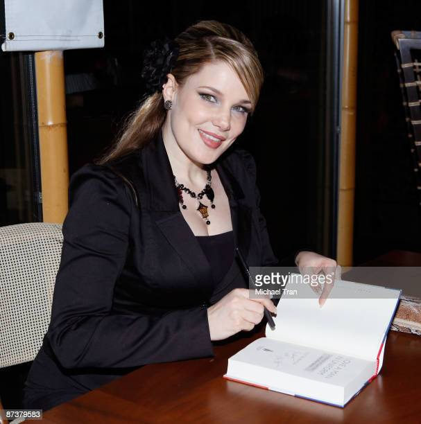 Author Lily Burana signs copies of her book Operation Bombshell a Burlesque Show and Benefit held at Trader Vic's At LA Live on May 15 2009 in Los...