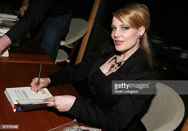 Author Lily Burana signs her book I Love a Man in Uniform at the Operation Bombshell benefit event at Trader Vic's on May 15 2009 in Los Angeles...