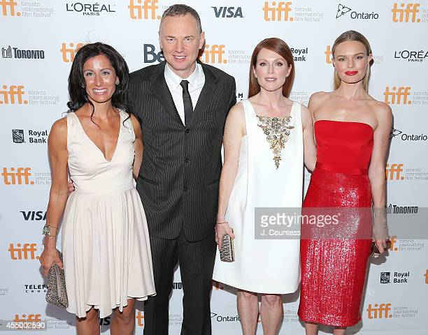 Author Lisa Genova cowriter/codirector Wash Westmore actress Julianne Moore and actress Kate Bosworth attend the Still Alice Premiere at the Winter...