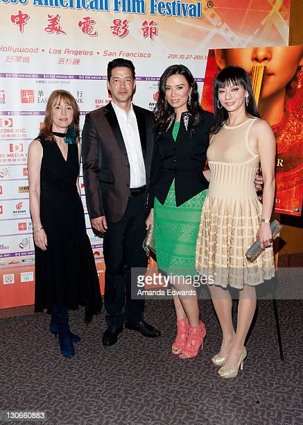 Author Lisa See actor Russell Wong and producers Wendi Deng Murdoch and Florence Sloan arrive at the Bluray DVD Release Of Twentieth Century Fox Home...