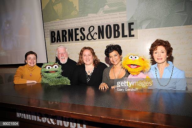 Author Louise Gikow puppeteer Caroll Spinney with 'Sesame Street' puppet Oscar the Grouch executive producer CarolLynn Parente puppeteer Sonia...