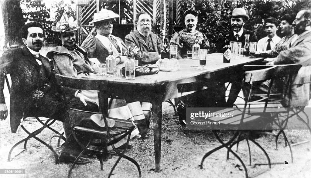 Marcel Proust Seated Outside at Table With Acquaintances : News Photo