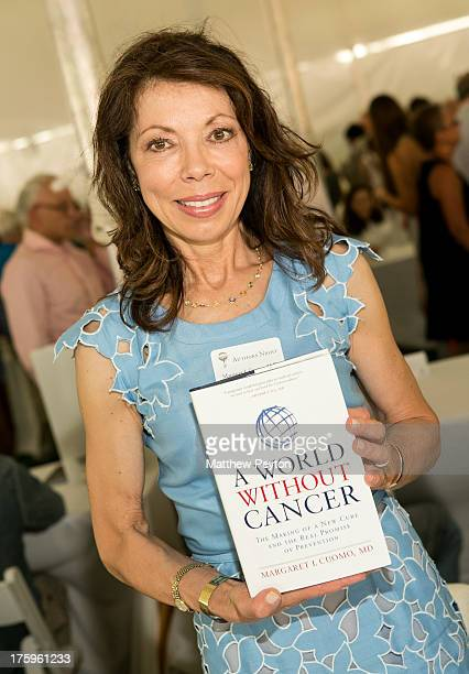 Author Margaret I Cuomo signs books during Authors Night For The East Hampton Library at Gardiner's Farm on August 10 2013 in East Hampton New York