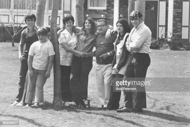 Author Mario Puzo with son Anthony son Joe wife Erika daughter Dorothy daughter Virginia and son Eugene standing by a tree in the yard of their...