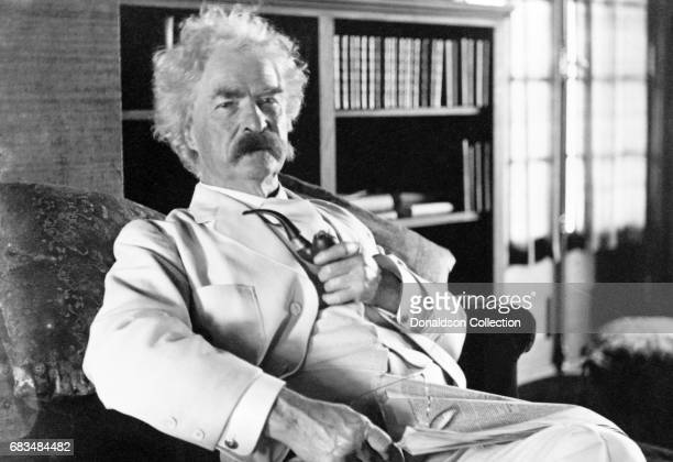 Author Mark Twain poses for a portrait in 1900