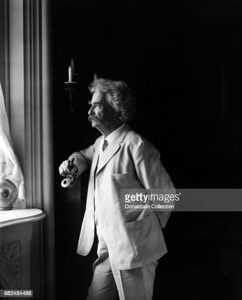 Author Mark Twain poses for a portrait in 1907