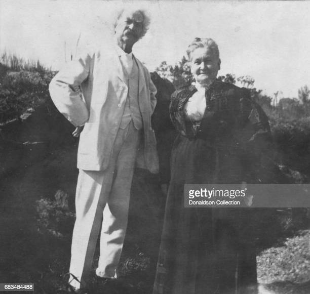 Author Mark Twain poses for a portrait with Anna Laura Hawkins Frazer who was the inspiration for Twain's character Becky Thatcher in Tom Sawyer and...