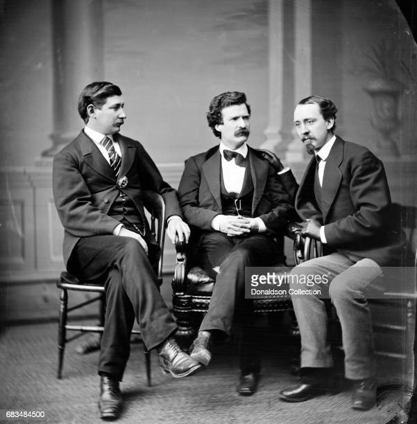 Author Mark Twain poses for a portrait with George Alfred Townsend and David Gray in 1865