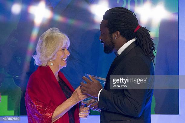Author Marlon James winning author of 'A Brief History of Seven Killings' collects his award from Camilla Duchess of Cornwall at the ceremony for the...