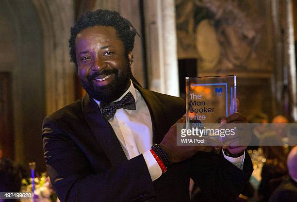 Author Marlon James winning author of 'A Brief History of Seven Killings' poses with his award at the ceremony for the Man Booker Prize for Fiction...