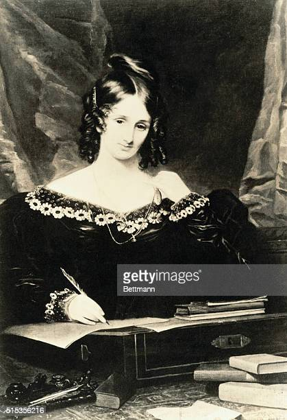 Author Mary Shelley writing at her desk