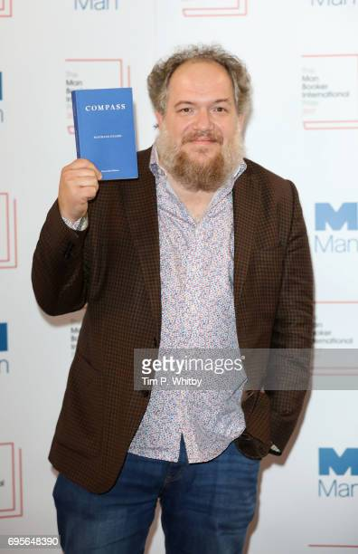 Author Mathias Enard of France with the book 'Compass' at a photocall for the shortlisted authors/translator for the Man Booker International Prize...