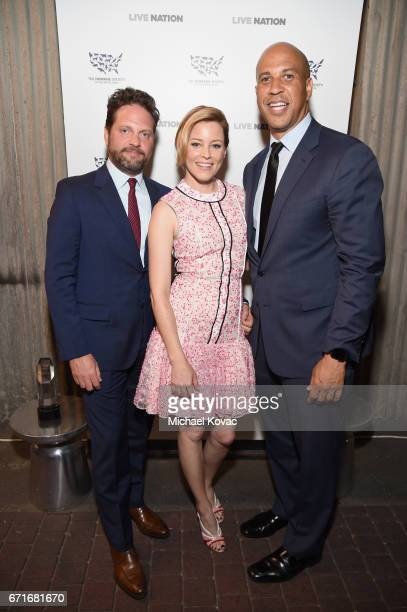Author Max Handelman Actor Elizabeth Banks and Honoree United States Senator Cory Booker at The Humane Society of the United States' To the Rescue...