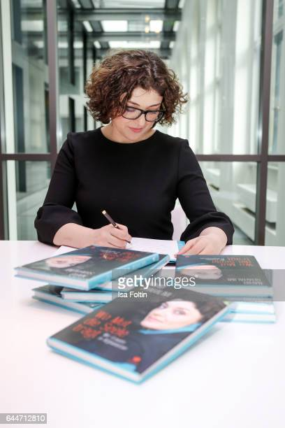 Author Nahid Shahalimi signs her book at Sofitel Munich Bayerpost on February 23 2017 in Munich Germany Shahalimi's book 'Wo Mut die Seele Traegt Wir...