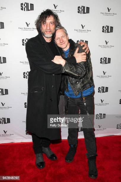 Author Neil Gaiman and director John Cameron Mitchell pose for photos on the red carpet for 'How To Talk To Girls At Parties' during the San...