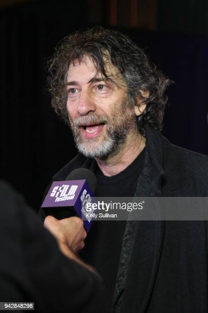 Author Neil Gaiman is interviewed on the red carpet for 'How To Talk To Girls At Parties' during the San Francisco Film Festival at the Castro...