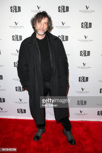 Author Neil Gaiman poses for photos on the red carpet for 'How To Talk To Girls At Parties' during the San Francisco International Film Festival at...