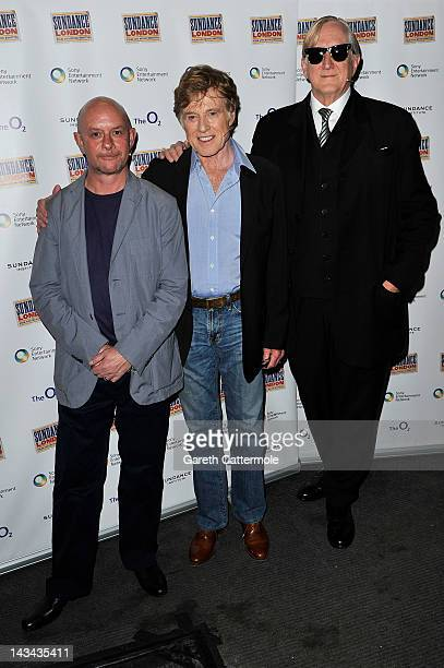 Author Nick Hornby founder and President of Sundance Institute Robert Redford and musician/producer TBone Burnett pose backstage at 'An Evening With...