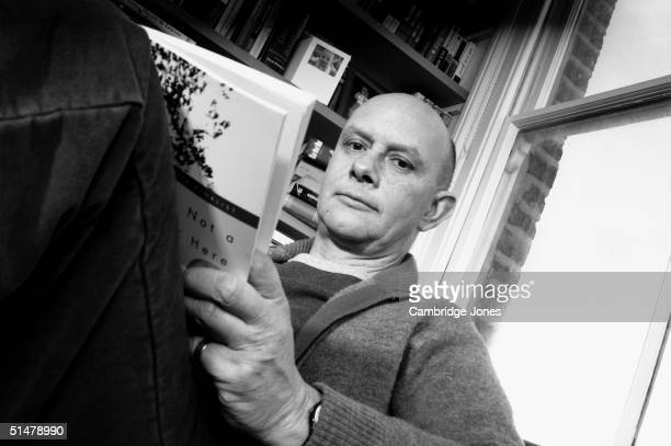 Author Nick Hornby of novel's High Fidelity and Fever Pitch poses during a photo call held on March 8 2004 at his home in London