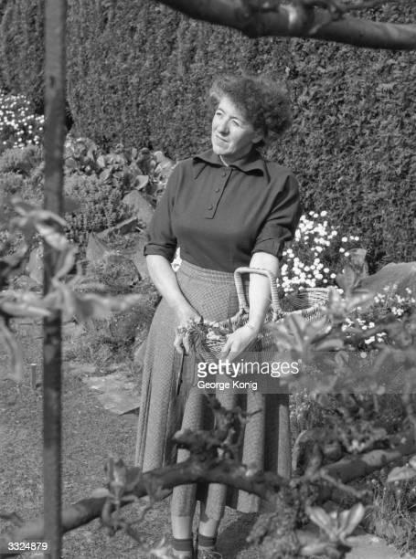 Author of children's books Enid Mary Blyton in her garden in Beaconsfield, Buckinghamshire.