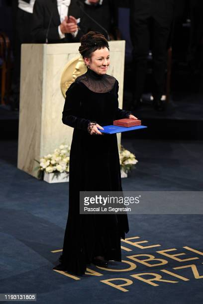Author Olga Tokarczuk, laureate of the Nobel Prize in Literature 2018 acknowledges applause after he received his Nobel Prize from King Carl XVI...
