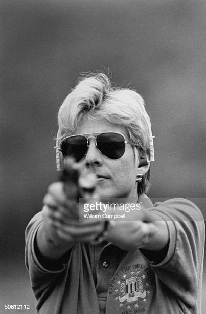 Author Patricia Cornwell wearing headphonestyle ear plugs w an extended arms twohanded grip on her 357 Colt Python pistol as she takes aim during...