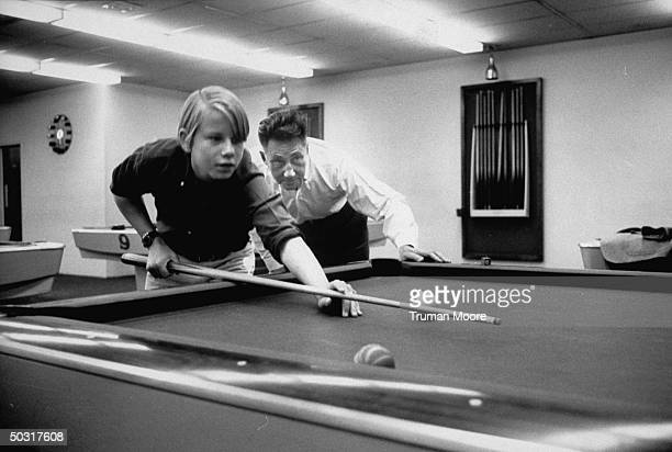 Author Peter De Vries playing a game of pool with his son