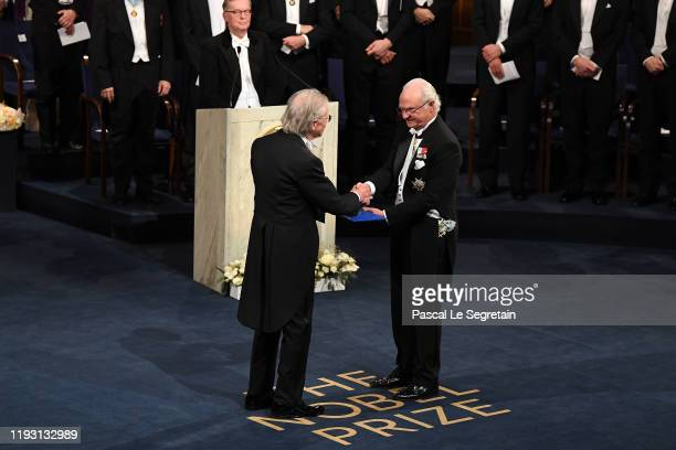 Author Peter Handke laureate of the Nobel Prize in Literature 2019 receives his Nobel Prize from King Carl XVI Gustaf of Sweden during the Nobel...