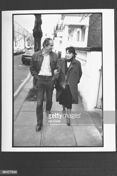 Author Philip Roth walking w his wife actress Claire Bloom on residential street