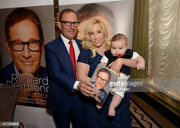 Author Richard Desmond with wife Joy and baby Valentine attend the book launch of Richard Desmond's 'The Real Deal' at Claridge's on June 15 2015 in...