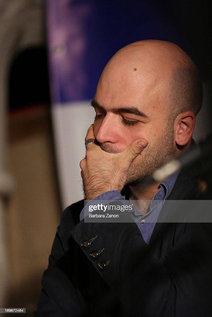 Author Roberto Saviano presents the book 'ZeroZeroZero' at La Toletta bookshop at La Pescheria di Rialto on June 3, 2013 in Venice, Italy. Italian author and journalist Saviano lives under police escort since 2006, after the publication of his book 'Gomorrah'.
