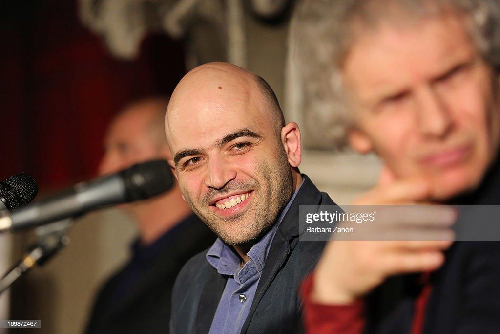 Author Roberto Saviano presents the book 'ZeroZeroZero' with Gianfranco Bettin at La Toletta bookshop at La Pescheria di Rialto on June 3, 2013 in Venice, Italy. Italian author and journalist Saviano lives under police escort since 2006, after the publication of his book 'Gomorrah'.