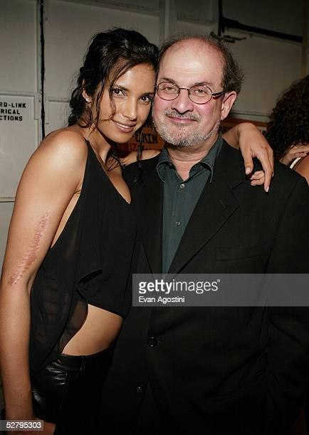 Author Salman Rushdie and girlfriend Padma Lakshmi pose backstage at the Luca Luca Spring/Summer 2004 Fashion Show during MercedesBenz Fashion Week...