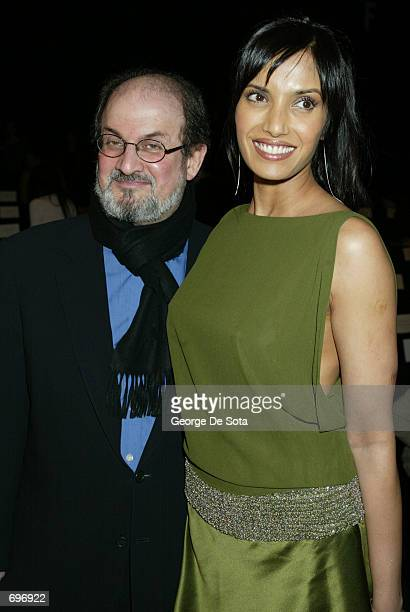 Author Salman Rushdie and his girlfreind Padma Lakshmi attend a show featuring the Luca Luca Fall/Winter 2002 Fashion Collection February 12 2002...