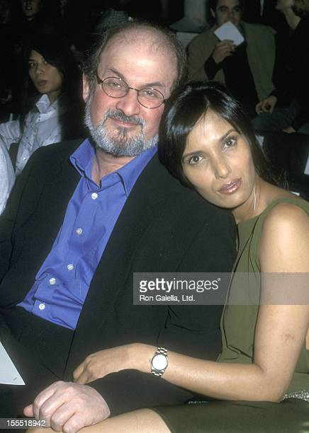 Author Salman Rushdie and model Padma Lakshmi attend the Fall 2002 Fashion Week Luca Luca Fashion Show on February 12 2002 at Bryant Park in New York...