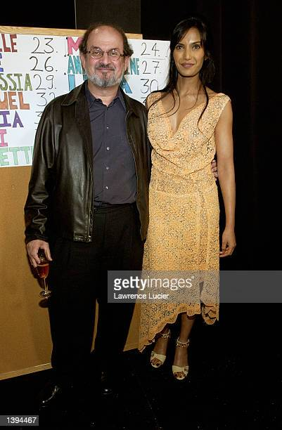 Author Salman Rushdie and Padma Lakshmi attend the Luca Luca Spring 2003 Collection at the Theater in Bryant Park during the MercedesBenz Fashion...