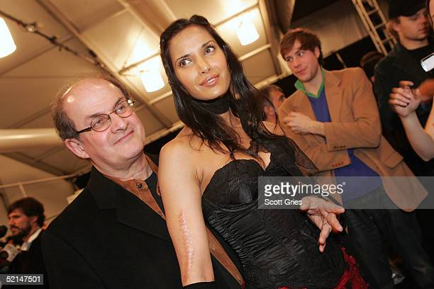 Author Salman Rushdie and Padma Lakshmi pose backstage at the Luca Luca Fall 2005 show during Olympus Fashion Week at Bryant Park February 6 2005 in...