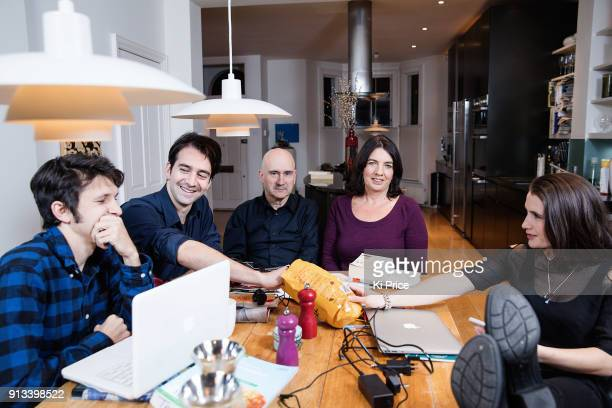 Author Sarah Long with her family photographed at home for the Daily Mail on December 3 2017 in London England