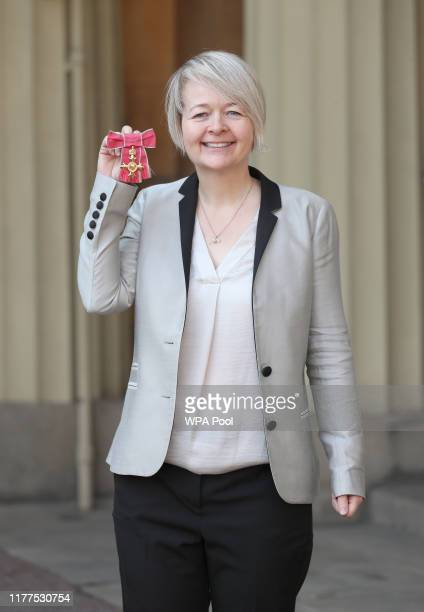 Author Sarah Waters poses with her Officer of the Order of the British Empire medal following an investiture ceremony at Buckingham Palace on October...