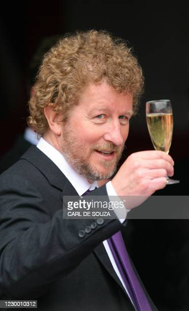 Author Sebastian Faulks raises a glass of champagne as he launches his new James Bond novel entitled 'Devil May Care' aboard HMS Exeter in London, on...