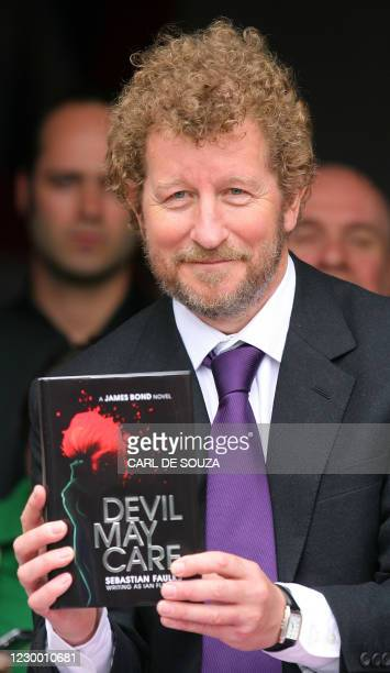 Author Sebastian Faulks takes receipt of one of the first copies of the new James Bond novel entitled 'Devil May Care' aboard HMS Exeter in London,...