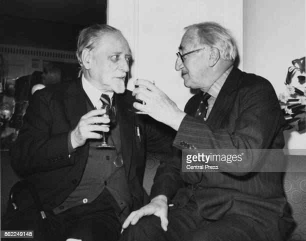 Author Sir Alan Patrick Herbert raises a glass to Sir Compton Mackenzie during a Foyles Literary Luncheon at the Dorchester Hotel in London, 17th...