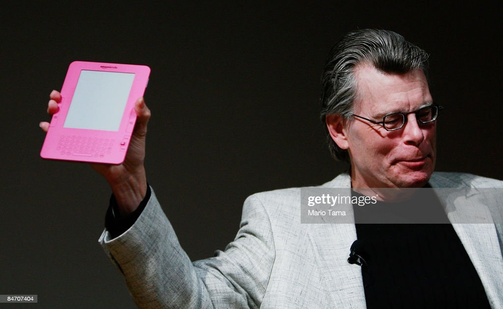 Author Stephen King holds a special pink Kindle given to him by Amazon.com founder and CEO Jeffrey P. Bezos at an unveiling event for the Amazon Kindle 2 at the Morgan Library & Museum February 9, 2009 in New York City. The updated electronic reading device is slimmer with new syncing technology and longer battery life and will begin shipping February 24th.
