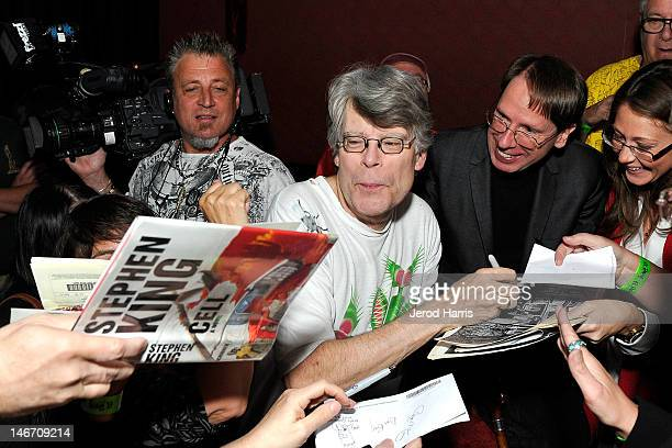 Author Stephen King signs autographs for fans prior to performing with the Rock Bottom Remainders at El Rey Theatre on June 22 2012 in Los Angeles...